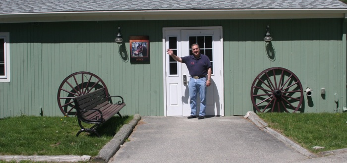 Chrislar barn entry with Larry Cassenti at the door giving a welcoming wave