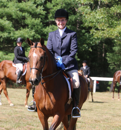 Chrislar student wins the blue ribbon in hunt seat class