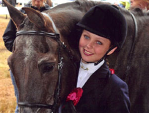student rider at a horse show